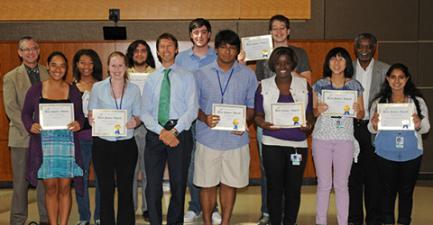 A group of trainees receive awards.