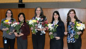 From left to right: Donna Calu, Hui Shen, Kenzie Preston, and two NIA scientist awardees.