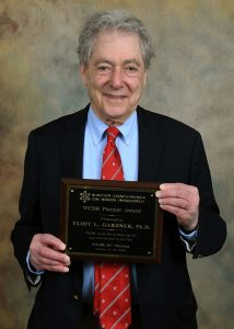 Eliot Gardner, Ph.D. with the Pioneer Award